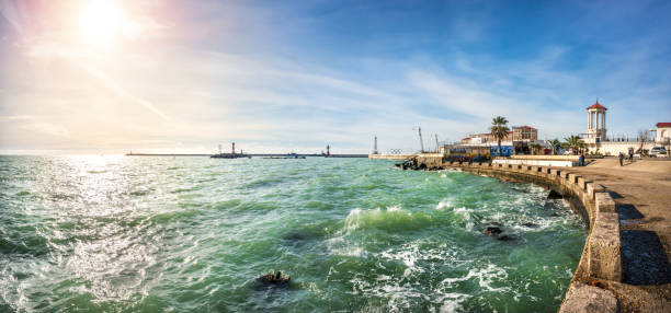 The emerald color of the Black Sea The emerald color of the Black Sea in Sochi and the sunlit embankment sochi stock pictures, royalty-free photos & images