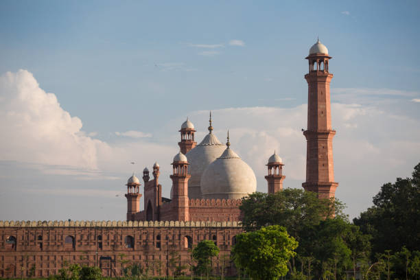 The Emperor's Mosque - Badshahi Masjid in Lahore, Pakistan Dome with Minarets exterior The Emperor's Mosque - Badshahi Masjid in Lahore, Pakistan Dome with Minarets exterior lahore pakistan stock pictures, royalty-free photos & images