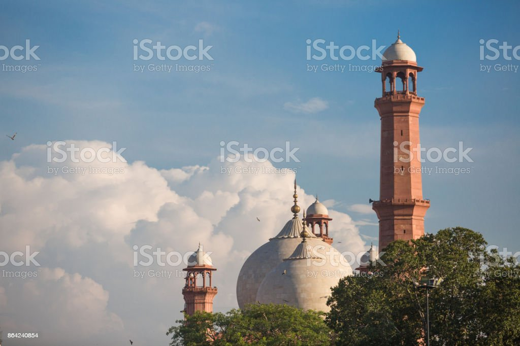 The Emperor's Mosque - Badshahi Masjid in Lahore, Pakistan Dome with Minarets with mystical clouds royalty-free stock photo