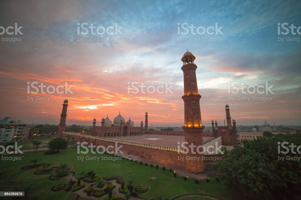 The Emperor's Mosque - Badshahi masjid wide angle full exterior at sunset royalty-free stock photo