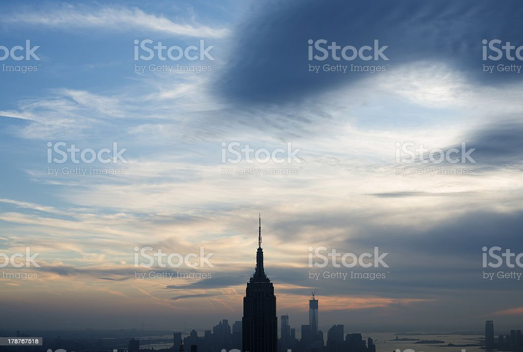 The Empire State building emerging above New York's skyline royalty-free stock photo