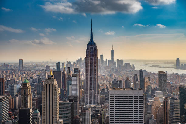 The Empire State Empire State Building as seen from Rooftop of Rockefeller Building new york state stock pictures, royalty-free photos & images