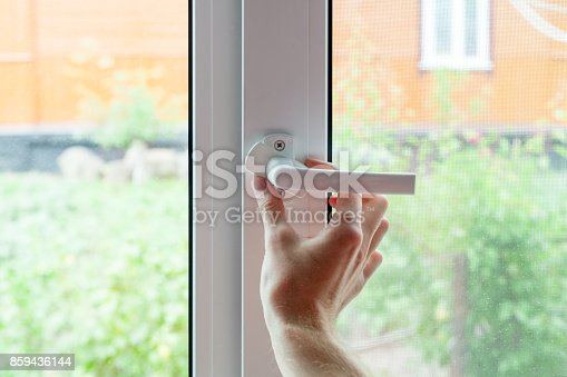 966792200 istock photo The employee opens a protective cap from the element of the plastic window. Preparing a plastic window for minor repairs 859436144