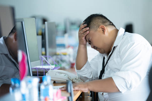 The employee was unemployed and was fired. He was in a feeling of regret and headache. stock photo