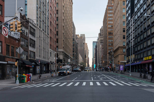 The empty street in the morning rush hours during Covid-19 outbreak The lifeless deserted 23rd Street in Manhattan Flatiron District during the COVID-19 Coronavirus outbreak. Manhattan, New York City, USA. flatten the curve stock pictures, royalty-free photos & images