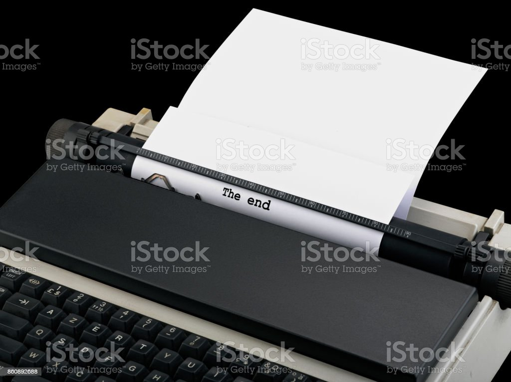'The end' message typed by vintage typewriter. stock photo