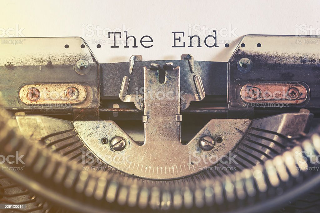 The end message written on a vintage typewriter stock photo