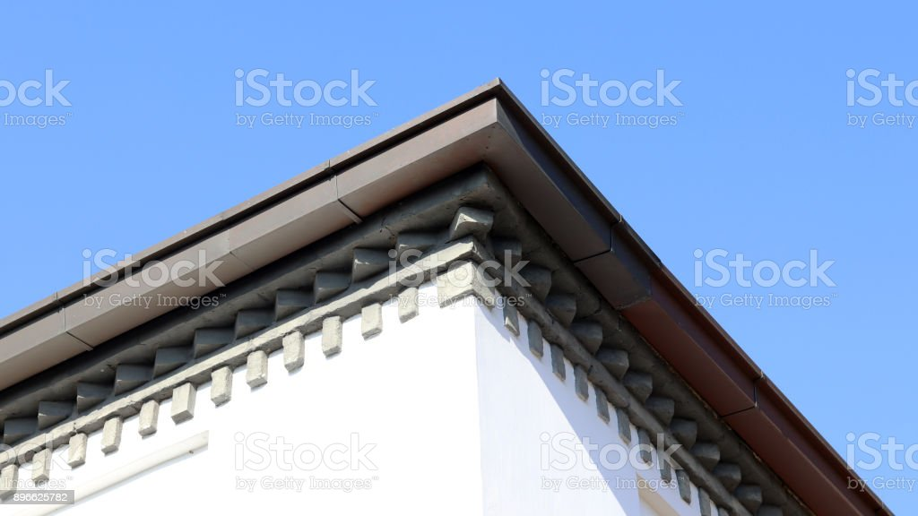 The end of a modern house roof against the sky stock photo