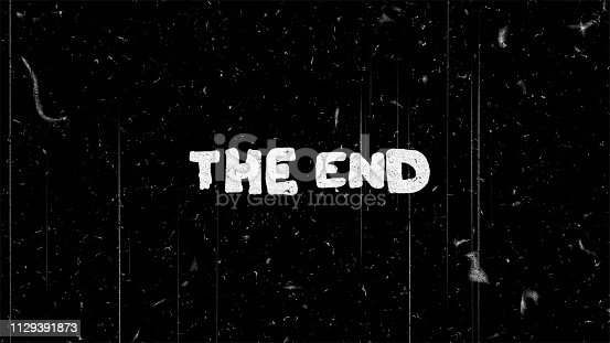The end white text on black with film noise