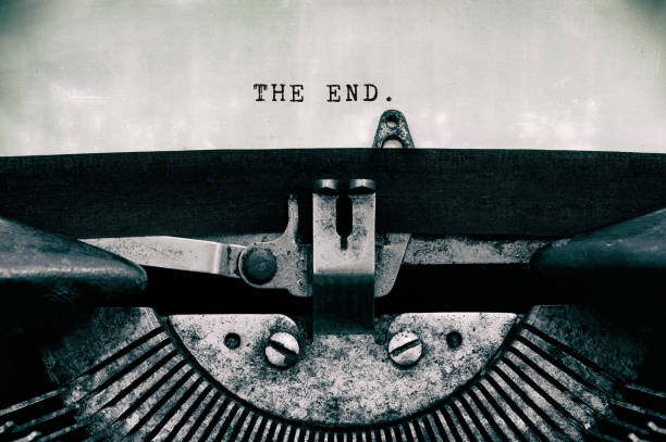 the end words typed on a vintage typewriter - finishing stock photos and pictures