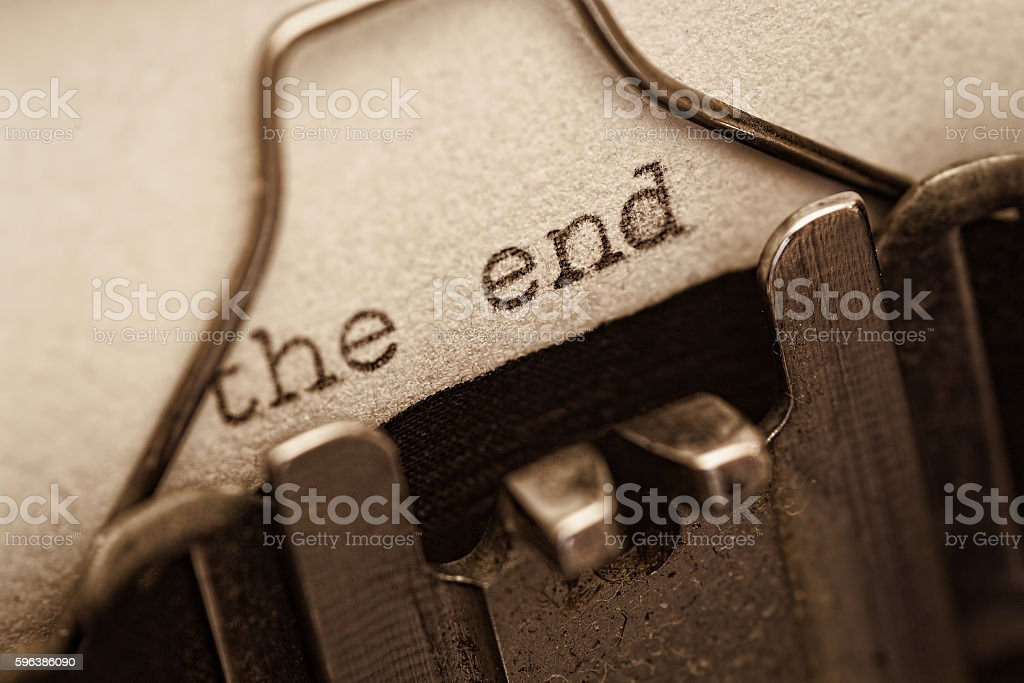 The end, words written on old vintage typewriter stock photo