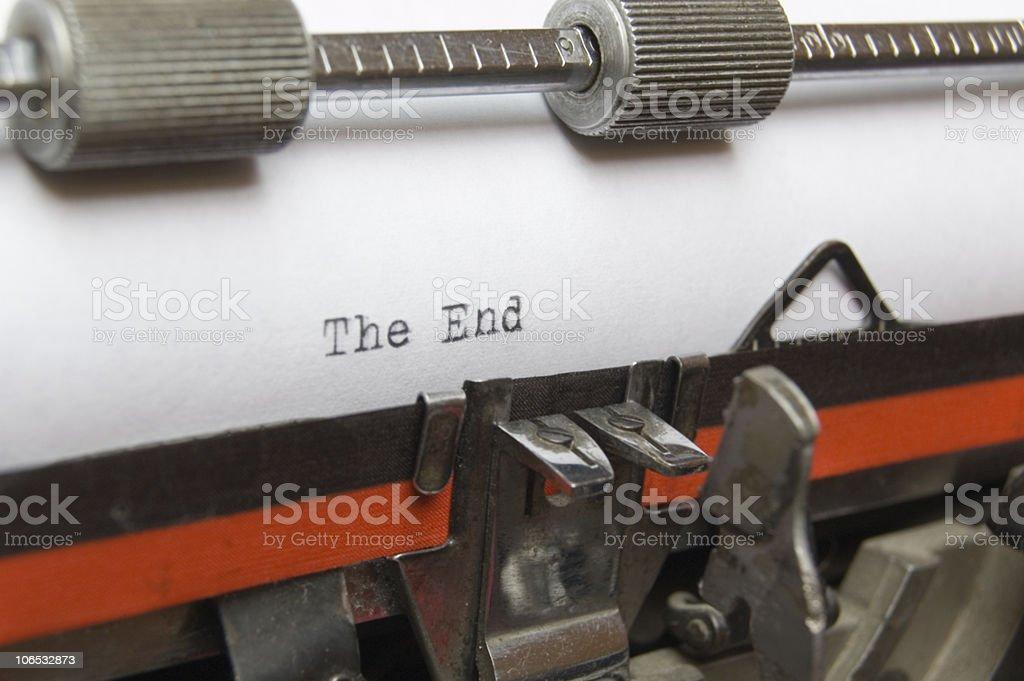 The End written on a typewriter stock photo