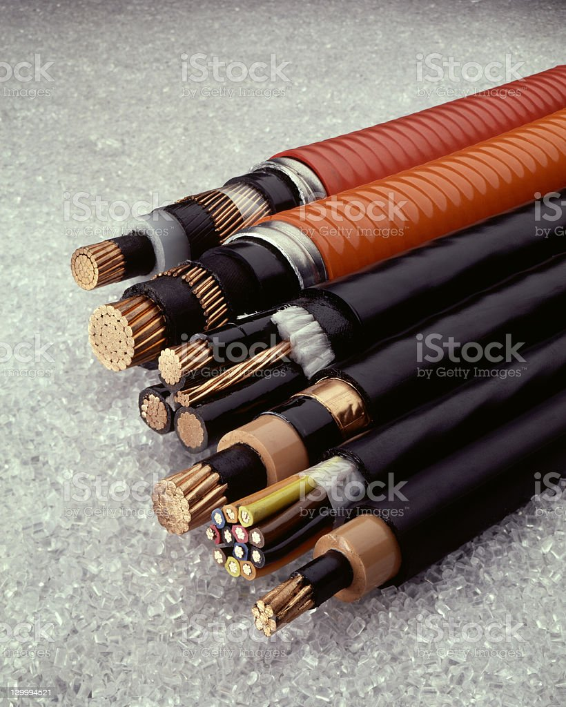 The ends of various cables exposed on concrete stock photo