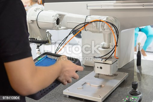istock The engineer control the robotic arm for manufacturing process. 978410904