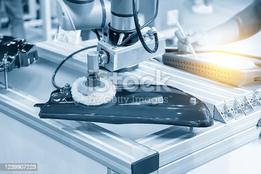 821521124 istock photo The engineer program robotic arm for polishing  automotive parts. 1239907223