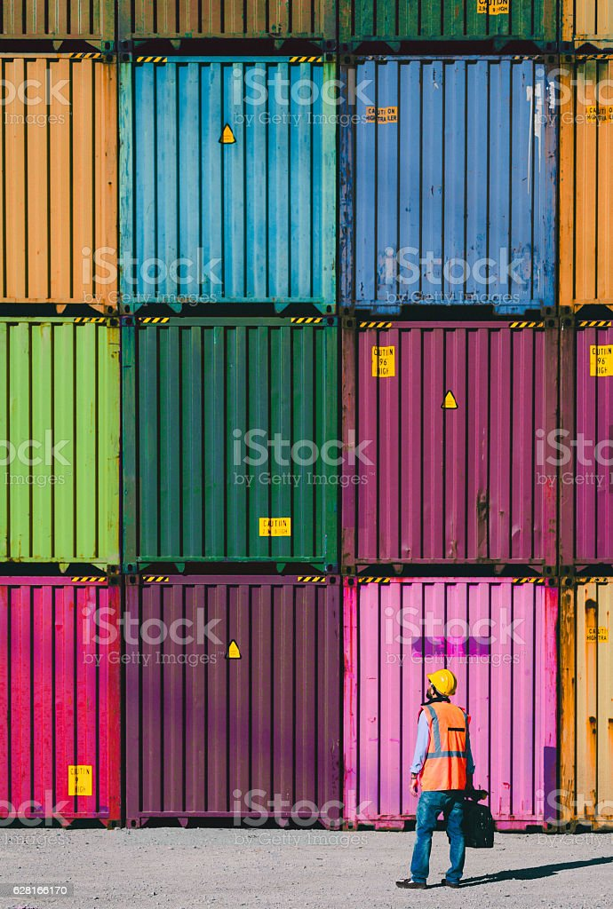 The engineer working with Cargo Containers stock photo
