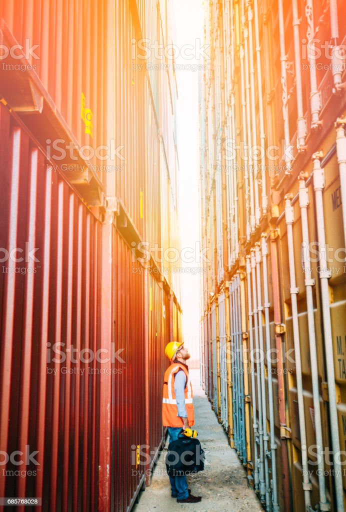 The engineer working with Cargo Containers royalty-free stock photo