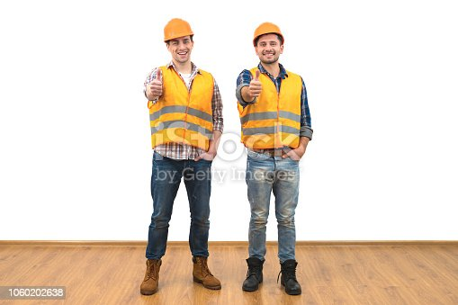 istock The engineers thumb up on the white wall background 1060202638