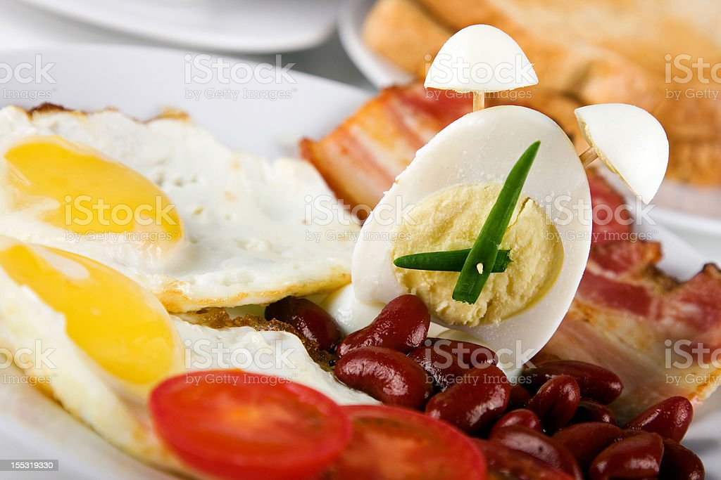 The English breakfast with alarm-egg royalty-free stock photo