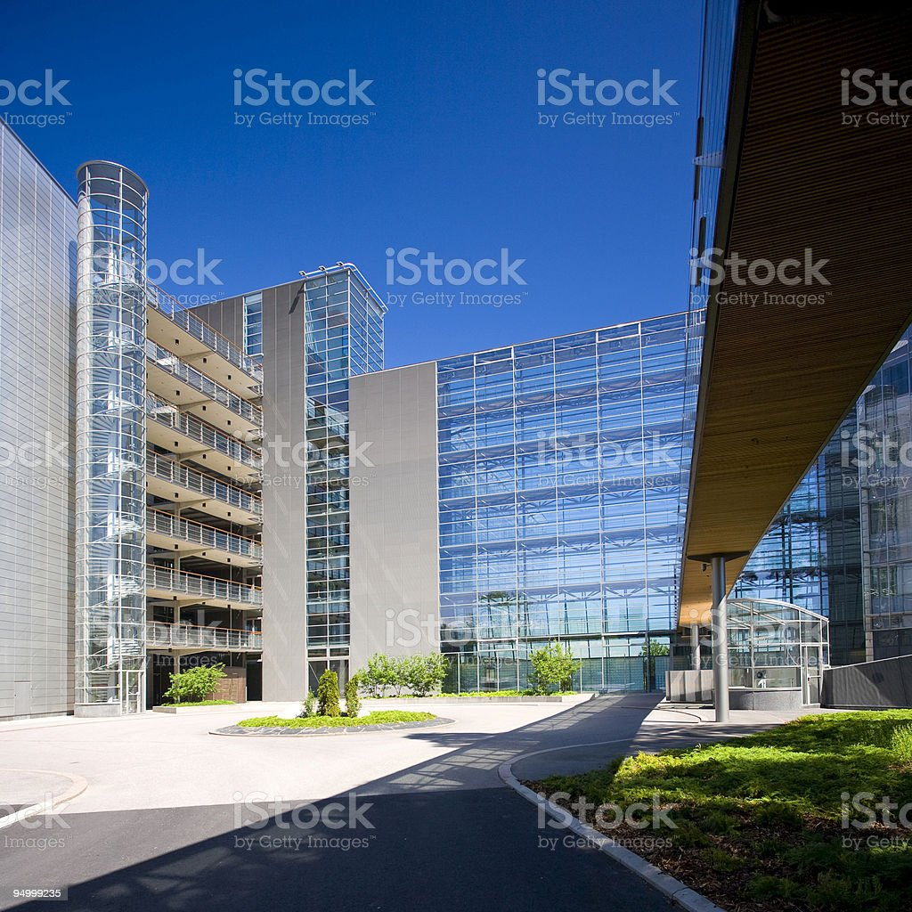 The entrance of a glass office park stock photo