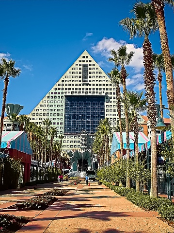 RLANDO, FL - Nov 5, 2015: The entrance to the Dolphin Hotel in Orlando, Florida, from the walkway that connects to the Swan, which is a sister to the Dolphin.