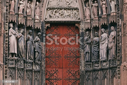 The entrance to the grand cathedral in Strasbourg, the main religious landmark of the city. The numerous sculptures adorning the cathedral are clearly visible.