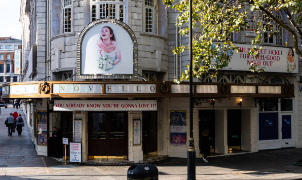 the entrance to the novello theatre which has been running the abba musical mamma mia since september 2012 on aldwych - mamma mia stock photos and pictures