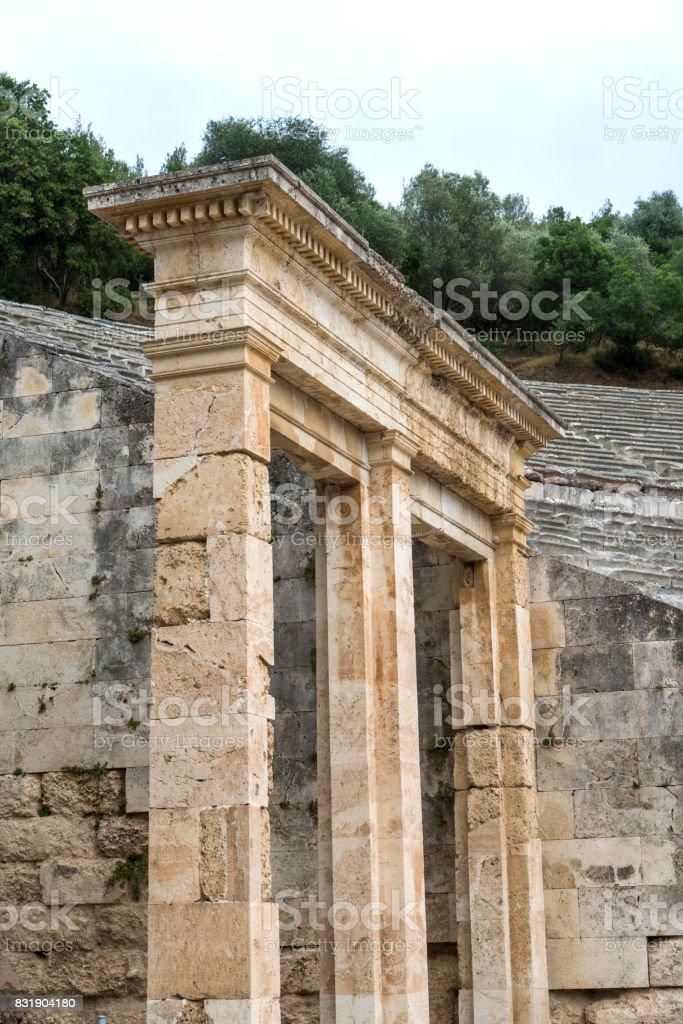 The Epidaurus Ancient Theatre column gate, Greece stock photo
