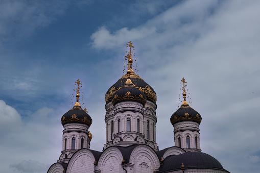 istock The Epiphany Cathedral. Gorlovka Ukraine. Domes on the blue sky background 693979938