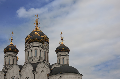 istock The Epiphany Cathedral. Gorlovka Ukraine. Domes on the blue sky background 693979970