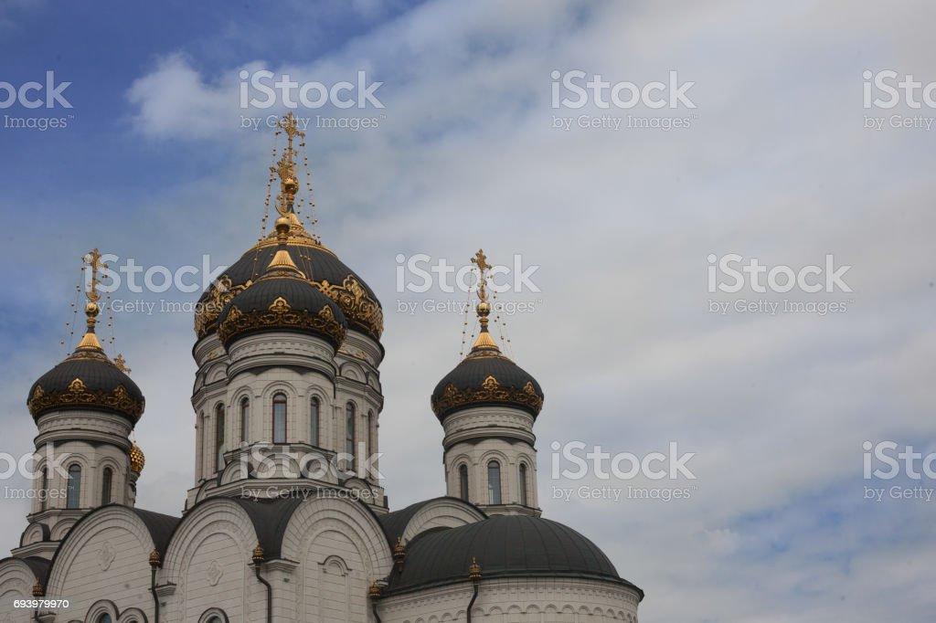 The Epiphany Cathedral. Gorlovka Ukraine. Domes on the blue sky background stock photo