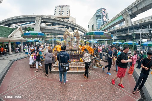 Tourists and worshipers at the Erawan Shrine, formally known as the Thao Maha Phrom Shrine in the centre of Bangkok, the Thai capital city.