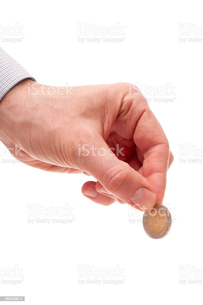 the Euro coin in the man's hand stock photo