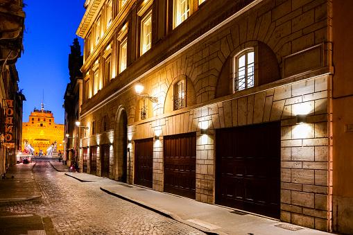 The evening lights illuminate a street near Castel Sant'Angelo in Rome