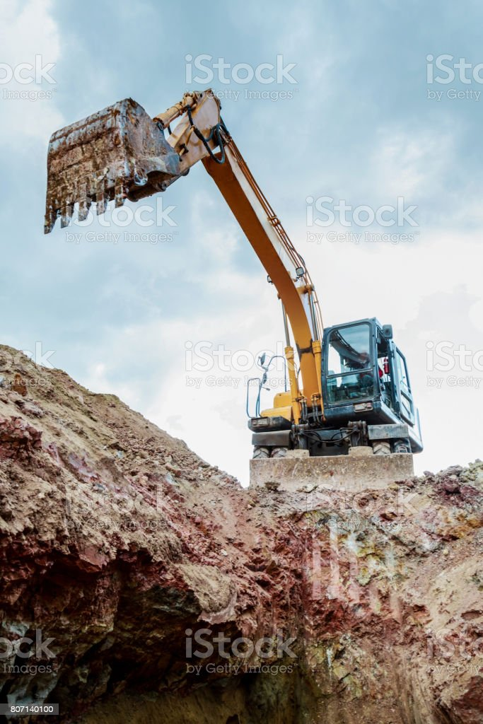The excavator lifted the bucket. Bottom view. stock photo