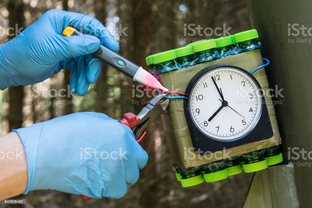 The expert carefully disables a dangerous time bomb. stock photo