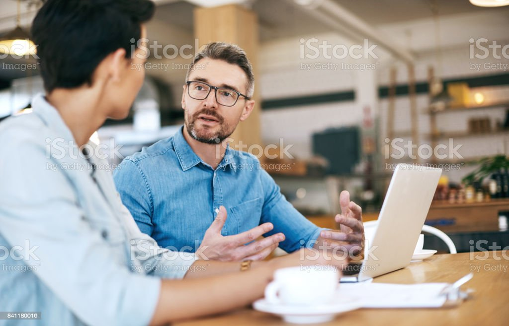 The experts at operating a successful coffee shop stock photo