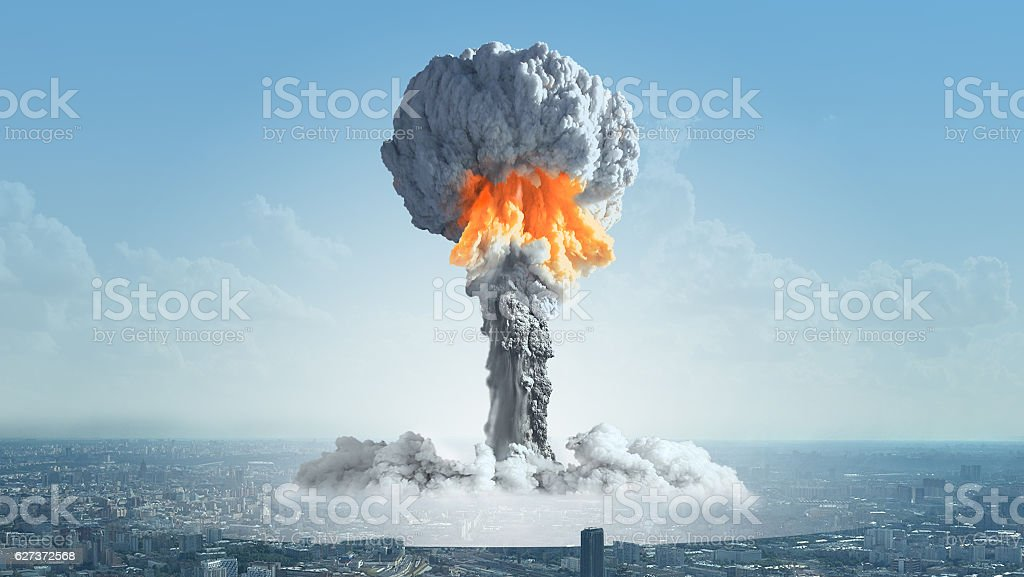 The explosion of a nuclear bomb in the city. The explosion of a nuclear charge in a big city. Nuclear Weapon Stock Photo