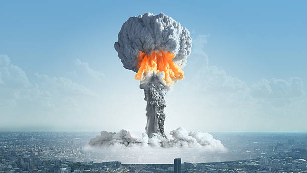 The explosion of a nuclear bomb in the city. The explosion of a nuclear charge in a big city. nuclear power station stock pictures, royalty-free photos & images