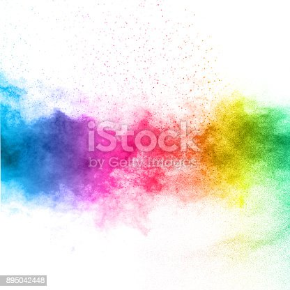 The explosion of multi colored powder. Beautiful rainbow color powder fly away. The cloud of glowing color powder on white background