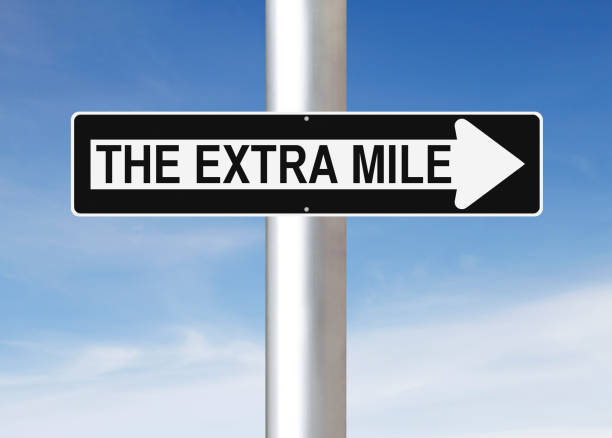 The Extra Mile This Way A modified one way sign indicating The Extra Mile dedicated stock pictures, royalty-free photos & images