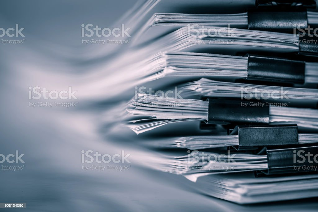 the extreamely close up  report paper stacking of office working document , retro color tone royalty-free stock photo