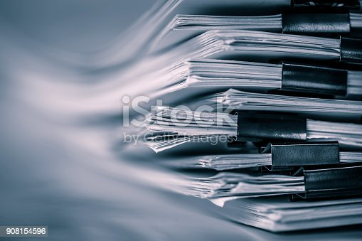 istock the extreamely close up  report paper stacking of office working document , retro color tone 908154596