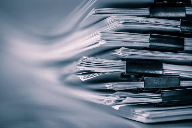 the extreamely close up  report paper stacking of office working document , retro color tone stock photo