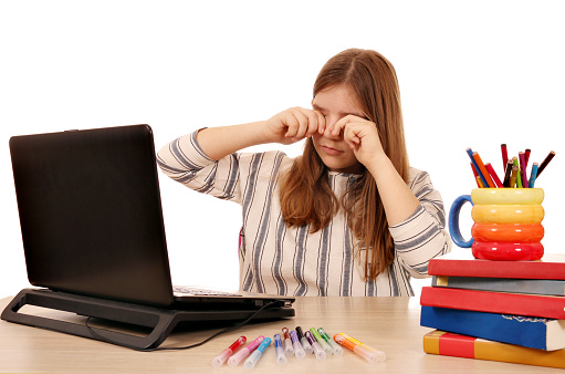 The Eyes Of The Little Girl Were Tired Of The Long Use Of The Laptop Stock Photo - Download Image Now