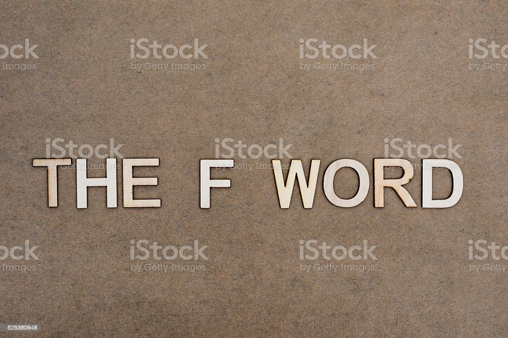 The F Word Concept with Wooden Letters on Craft Paper stock photo
