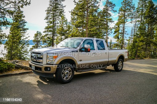 Yellowstone National Park, WY, USA - August 27, 2018: The F350 Ford parked along the preserve park