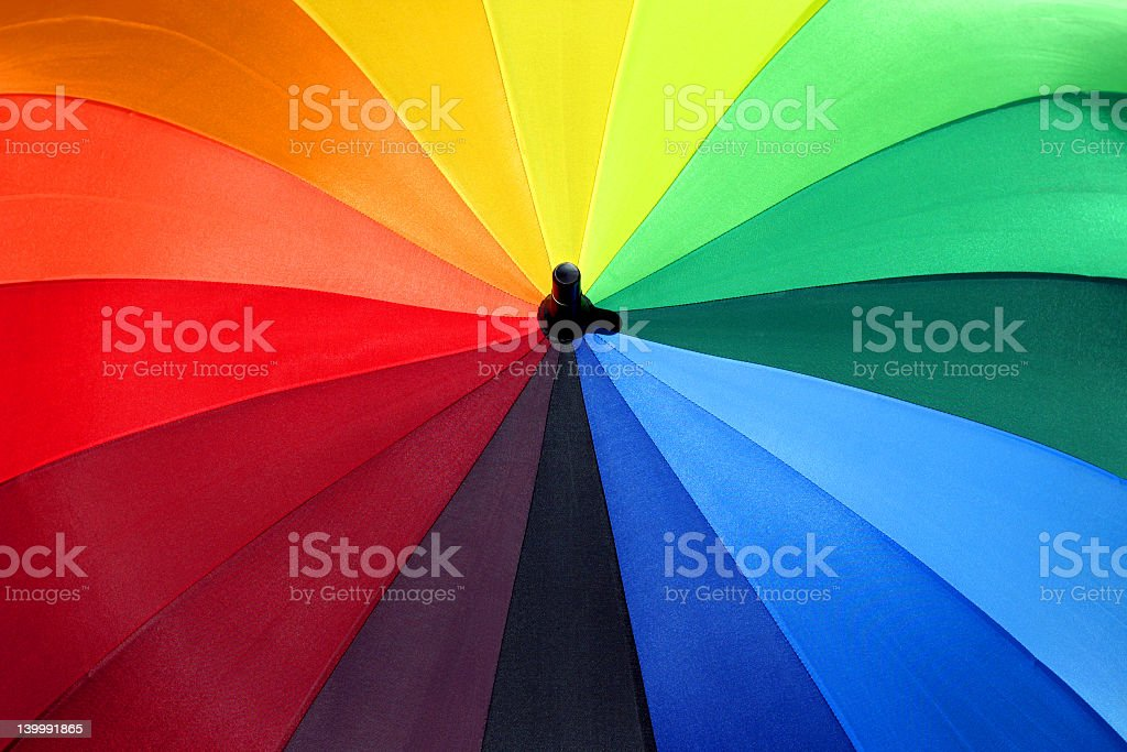 Multicolored umbrella brings brightness on rainy days