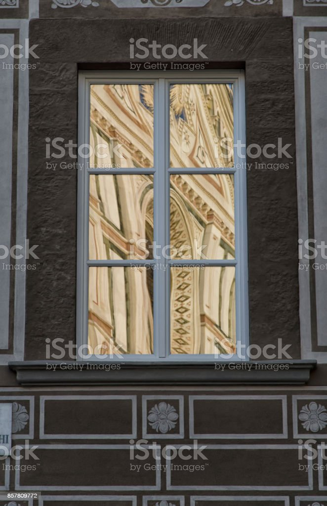 The facade of a basilica reflected stock photo