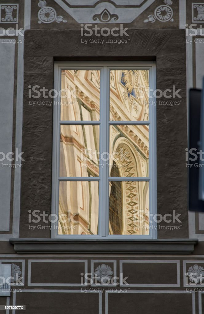 The facade of a church reflected stock photo